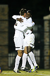 25 October 2013: Wake Forest's Sean Okoli (right) celebrates his goal with Sam Fink (5). The Duke University Blue Devils hosted the Wake Forest University Demon Deacons at Koskinen Stadium in Durham, NC in a 2013 NCAA Division I Men's Soccer match. The game ended in a 2-2 tie after two overtimes.