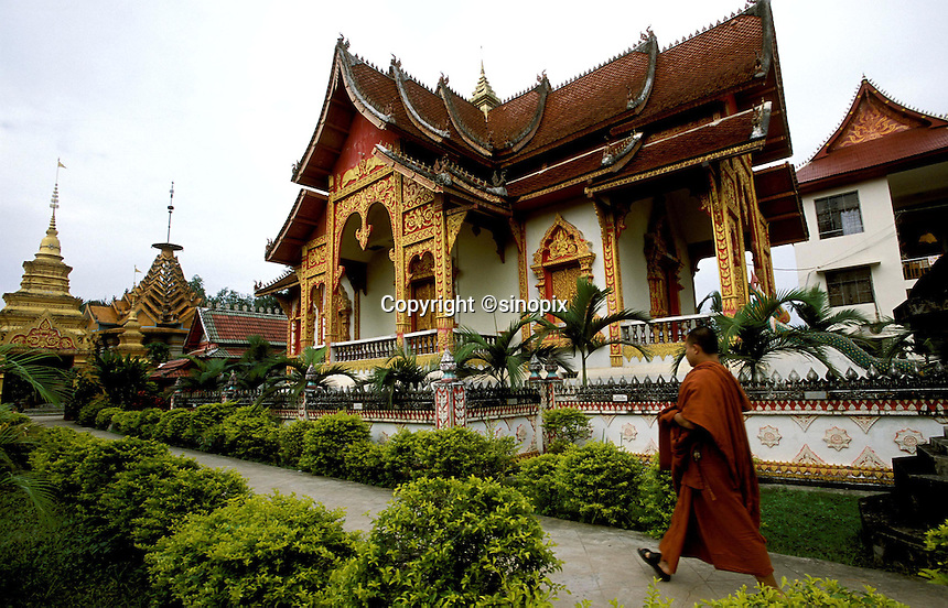 A monk inside a Dai temple and school for monks near Jinghong, Xishuangbanna region, Yunnan. Xishuangbanna is home of the buddhist Dai minority..01-NOV-02
