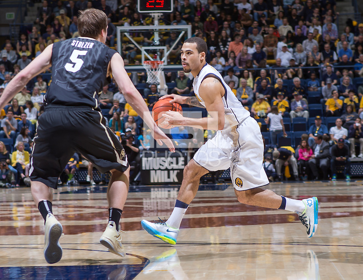 California's Justin Cobbs works against Colorado's Eli Stalzer during a game at Haas Pavilion in Berkeley, California on March 8th, 2014. California defeated Colorado 66 - 65