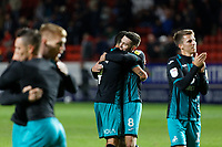 Borja Baston and Matt Grimes of Swansea City embrace each other after the final whistle during the Sky Bet Championship match between Charlton Athletic and Swansea City at The Valley, London, England, UK. Wednesday 02 October 2019