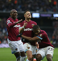 West Ham United's Javier Hernandez celebrates scoring his side's fourth goal with Angelo Ogbonna and Issa Diop<br /> <br /> Photographer Rob Newell/CameraSport<br /> <br /> The Premier League - West Ham United v Huddersfield Town - Saturday 16th March 2019 - London Stadium - London<br /> <br /> World Copyright © 2019 CameraSport. All rights reserved. 43 Linden Ave. Countesthorpe. Leicester. England. LE8 5PG - Tel: +44 (0) 116 277 4147 - admin@camerasport.com - www.camerasport.com