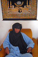 "- a small community of Tuareg, the legendary ""blue men"" of Sahara, coming from, Niger has settled in Pordenone, town of Italian northeast, being able to achieve a good degree of integration although in the respect of their traditional culture; Mohamed Abety in the home where he lives....- una piccola comunità di Tuareg, i leggendari ""uomini blu"" del Sahara, provenienti dal Niger, si sono stabiliti a Pordenone, città del nord-est italiano, riuscendo a conseguire un buon grado di integrazione pur nel rispetto della loro cultura tradizionale; Mohamed Abety nella casa dove abita"