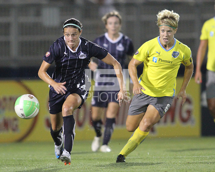 Sarah Huffman #14 of the Washington Freedom races for a loose ball with Lori Lindsey #6 of the Philadelphia Independence during a WPS match on August 4 2010 at the Maryland Soccerplex, in Boyds, Maryland.Freedom won 2-0.