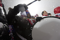 Under a heavy snowfall, A USA fans bangs a drum while watching the USA Men's National Team's World Cup Qualifier against Costa Rica at Dick's Sporting Good Park in Commerce City, CO on March 22, 2013.