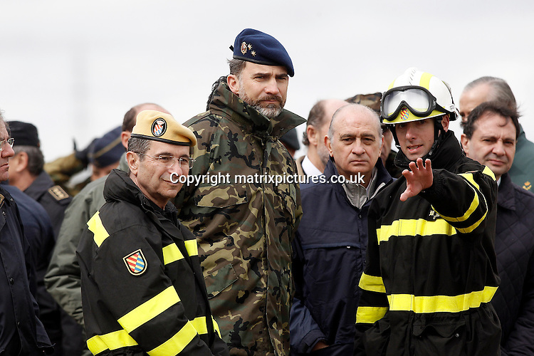 NON EXCLUSIVE PICTURE: MATRIXPICTURES.CO.UK.PLEASE CREDIT ALL USES..UK, AUSTRALIA, NEW ZEALAND AND ASIA RIGHTS ONLY..Spanish Crown Prince Felipe is pictured attending a military exercise titled 'Operation Gamma Palazuelos 2013' with the Spanish Military Emergencies Unit in Segovia today...The operation is considered to be Spain's largest disaster drill, preparing for natural disasters as well as nuclear and chemical accidents...MARCH 11th 2013..REF: KDA 131644..NOR
