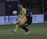 Jason Naismith clears before being tackled by Jamie Reckord in the Ross County v St Mirren Scottish Professional Football League match played at the Global Energy Stadium, Dingwall on 17.1.15.