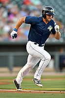 Left fielder Tim Tebow (15) of the Columbia Fireflies runs toward first in a game against  the West Virginia Power on Thursday, May 18, 2017, at Spirit Communications Park in Columbia, South Carolina. Columbia won in 10 innings, 3-2. (Tom Priddy/Four Seam Images)
