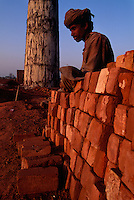 Worker at Brick Factory.<br /> Just outside the Harappa site they are making bricks the same way the ancient Harappans did, by burying clay bricks and burning rice husks for fuel to fire the bricks.