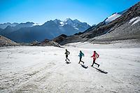 Descending the Schölligletscher on the way down to Randa while running the Via Valais, a multi-day trail running tour connecting Verbier with Zermatt, Switzerland.