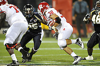 11 September 2010:  FIU cornerback Jonathan Cyprien (25) pursues Rutgers running back Joe Martinek (38) in the second quarter as the Rutgers Scarlet Knights defeated the FIU Golden Panthers, 19-14, at FIU Stadium in Miami, Florida.