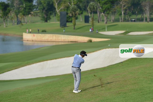 Afif RAZIF (MAS) hits his approach shot on 5 during Rd 1 of the Asia-Pacific Amateur Championship, Sentosa Golf Club, Singapore. 10/4/2018.<br /> Picture: Golffile | Ken Murray<br /> <br /> <br /> All photo usage must carry mandatory copyright credit (© Golffile | Ken Murray)