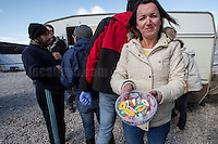 """Sarah.<br /> <br /> First Aid Camp - Second Team.<br /> <br /> Calais Jungle Camp.<br /> <br /> Under the Sky of Calais & Dunkirk. Two Camps, Two Sides of the Same Coin: Not 'migrants', Not 'refugees', just Humans.<br /> <br /> France, 24-30/03/2016. Documenting (and following) Zekra and her experience in the two French camps at the gate of the United Kingdom: Calais' """"Jungle"""" and Dunkirk's """"Grande-Synthe"""". Zekra lives in London but she is originally from Basra in Iraq. Zekra and her family had to flee Kuwait - where they moved for working reason - due to the """"Gulf War"""", and to the Western Countries' will to """"export Democracy in Iraq"""". Zekra is a self-motivated volunteer and founder of """"Happy Ravers"""", a group of people (not a NGO or a charity) linked to each other because of their love for rave parties but also men and women who meet up every week to help homeless people and other people in need in Central London. (Here there are some of the stories I covered about Zekra and """"Happy Ravers"""": http://bit.ly/1XVj1Cg & http://bit.ly/24kcGQz & http://bit.ly/1TY0dPO). Zekra worked as an English teacher in the adult school at Dunkirk's """"Grande-Synthe"""" camp and as a cultural mediator and Arabic translator for two medic teams in Calais' """"Jungle"""". Please read her story at the beginning of this reportage."""