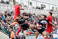 PICTURE BY VAUGHN RIDLEY/SWPIX.COM...Rugby League - International Friendly - England Knights v France - Leigh Sports Village, Leigh, England - 15/10/11…England's Josh Charnley wins a high ball over France's Cyril Stacul.