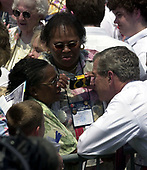 Washington, DC - May 15, 2004 -- United States President George W. Bush shares some thoughts with family members following his remarks at the Annual Peace Officers' Memorial Service on the West Lawn of the United States Capitol in Washington, D.C. on May 15, 2004.  The service, sponsored by the Fraternal Order of Police (FOP), is held annually on May 15 to honor those who gave their lives during the previous year and to honor their families.  The service remembers the sacrifice of the more than 15,000 officers who have been killed in the line of duty since 1794.<br /> Credit: Ron Sachs / CNP<br /> (RESTRICTION: NO New York or New Jersey Newspapers or newspapers within a 75 mile radius of New York City)