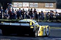 Porsche 956 driven by Volkert Merl, Dieter Schornstein, John Winter goes through the Mulsanne Corner during the 1984 24 Hours of Le Mans auto race.