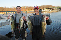 NWA Democrat-Gazette/FLIP PUTTHOFF <br /> Jason Hargis (left) and Russell Taylor show four of the bass they caught Sunday Jan. 1 2017 to finish second at the annual Polar Bear Memorial Bass tournament at Beaver Lake.