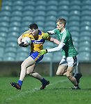 Conor Finucane of Clare  in action against Anthony Barrett of Limerick during the Mc Nulty Cup U-21 final at The Gaelic Grounds. Photograph by John Kelly.