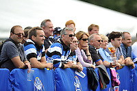 Bath supporters watch the action on the pitch. Pre-season friendly match, between Bath Rugby and the Scarlets on August 16, 2014 at the Recreation Ground in Bath, England. Photo by: Patrick Khachfe / Onside Images