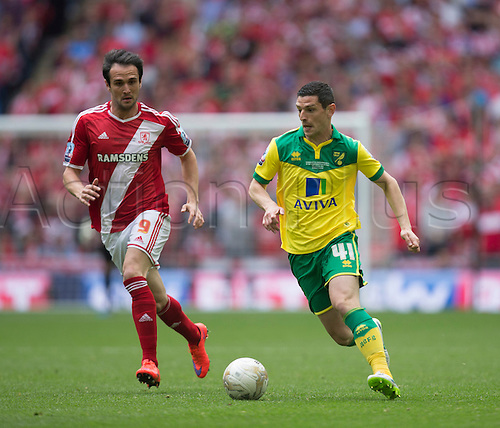 25.05.2015.  London, England. Skybet Championship Playoff Final. Middlesborough versus Norwich. Norwich City's Graham Dorrans brings the ball forward.