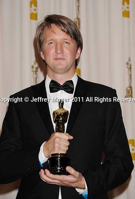 HOLLYWOOD, CA - FEBRUARY 27: Tom Hooper poses in the press room during the 83rd Annual Academy Awards held at the Kodak Theatre on February 27, 2011 in Hollywood, California.