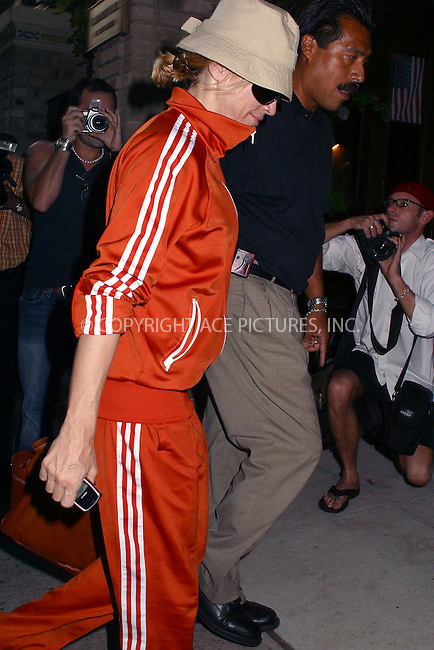 Perhaps Madonna does not want other people to recognize her as she puts on large black sunglasses and a hat. But it seems she does not want to look like an average New Yorker either--as she wears that bright red sports suit. New York, September 9, 2002. Please byline: Alecsey Boldeskul/NY Photo Press.   ..*PAY-PER-USE*      ....NY Photo Press:  ..phone (646) 267-6913;   ..e-mail: info@nyphotopress.com