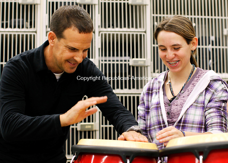 Torrington, CT- 05, November 2010-110510CM02  Grammy Award-winning jazz percussionist, Joe McCarthy, left, teaches Brittany Brown, a junior at Torrington High School various beat patterns on the conga drums Friday afternoon at Torrington High School.  McCarthy was on hand at the school putting on a free Jazz Clinic for the students.   Christopher Massa Republican-American