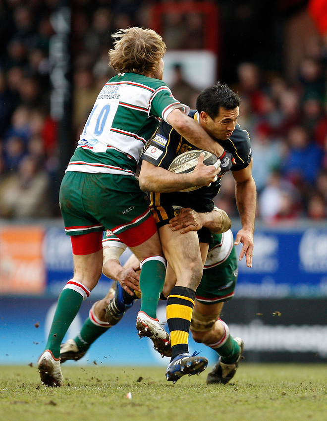 Photo: Richard Lane/Richard Lane Photography..Leicester Tigers v London Wasps. Guinness Premiership. 29/03/2008. Wasps' Riki Flutey is tackled by Tigers' Andy Goode.