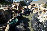 Paula Tungmanelatkul goes through garbage bags full of clothes that were damaged by the flood in the Nashville suburb of Bellevue on Saturday, May 8, 2010.