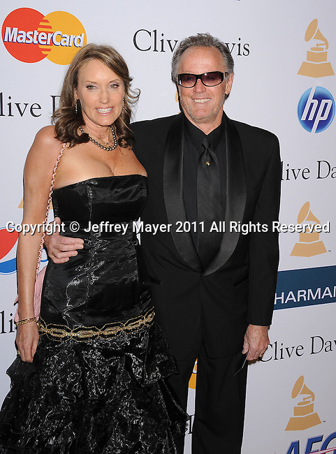 BEVERLY HILLS, CA - FEBRUARY 12: Peter Fonda and Parky DeVogelaere arrive at the 2011 Pre-GRAMMY Gala and Salute To Industry Icons Honoring David Geffen at The Beverly Hilton Hotel on February 12, 2011 in Beverly Hills, California.