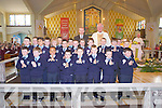 Pupils from St Mary's Boys NS who received their 1st holy communion, pictured here last Saturday with Mr Woulfe and Fr O'Shea in the Church of The Assumption, Abbeyfeale.