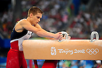 Aug. 9, 2008; Beijing, CHINA; Alexander Artemev (USA) prepares to perform on the pommel horse during mens gymnastics qualification during the Olympics at the National Indoor Stadium. Mandatory Credit: Mark J. Rebilas-
