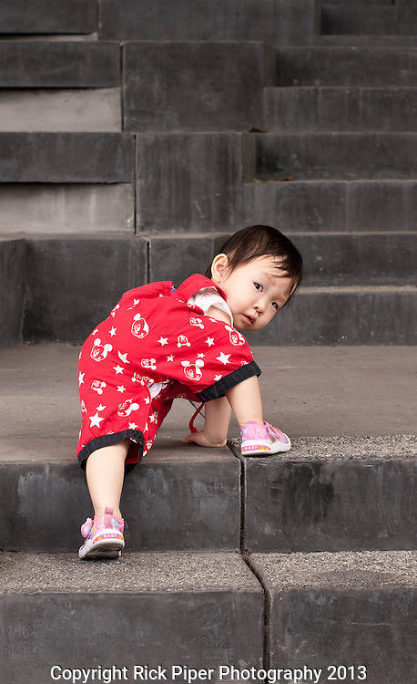 Climber 03 - Young Chinese girl climbing the concrete steps of the School Of The Arts (SOTA), Singapore