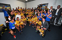 Prince Harry (centre) poses with the Hurricanes team in the changing rooms after the Super Rugby match between the Hurricanes and Sharks at Westpac Stadium, Wellington, New Zealand on Saturday, 9 May 2015. Photo: Dave Lintott / lintottphoto.co.nz