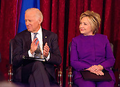 United States Vice President Joe Biden and former US Secretary of State Hillary Clinton attend the ceremony where the official portrait of US Senate Minority Leader Harry Reid (Democrat of Nevada) is to be unveiled in the Kennedy Caucus Room on Capitol Hill in Washington, DC on Thursday, December 8, 2016.<br /> Credit: Ron Sachs / CNP