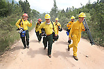 SPEARFISH, SD - JULY 1, 2016 -- Beth Doten, left, of the U.S. Forest Service escorts media along Higgins Gulch Road for coverage of the mop-up efforts at the Crow Peak Fire west of Spearfish, S.D. Friday. (Photo by Richard Carlson/dakotapress.org)