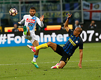 Lorenzo Insigne of SSC Napoli and Joao Mario  during the  italian serie a soccer match,between Inter FC  and SSC Napoli      at  the San Siro   stadium in Milan  Italy , April  30, 2017