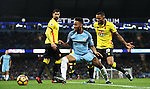 Raheem Sterling of Manchester City and Jerome Sinclair of Watford during the English Premier League match at The Etihad Stadium, Manchester. Picture date: December 12th, 2016. Photo credit should read: Lynne Cameron/Sportimage