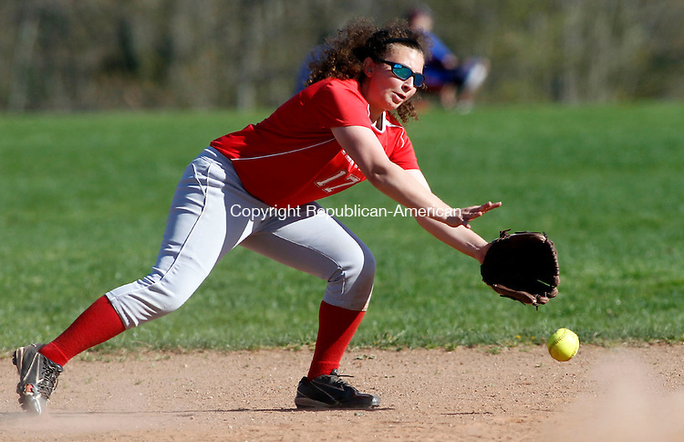 Southbury, CT- 03 May 2013-050313CM07- Pomperaug's Diane Isaacs lets a grounder slip past her against Stratford during SWC softball action in Southbury Friday afternoon.  Christopher Massa Republican-American