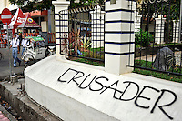 "Graffiti reading ""Crusader"" (Christian Holy Warrior) in the Christian area of Ambon City near to the main Catholic Cathedral. The 1999-2002 religious war between Maluku's Christian and Muslim populations, mainly centred on Ambon Island, led to over 5000 deaths and to around 500,000 people become displaced. Destroyed homes and offices, churches and mosques are slowly being either torn-down or renovated.  Urban centres, such as Ambon City, continue to be split along largely sectarian lines, and tensions are never far below the surface. Riots between Christian and Muslim youths erupted in September 2011 and, most recently, June 2012, though luckily simmered down just as quickly, partly due to community leaders learning how to defuse tensions from the earlier, more devastating, conflagration. /Felix Features"