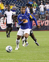 Cruzeiro forward Eber (17) heads towards the Revolution goal after evading a tackle by New England Revolution defender Emmanuel Osei (5).  Brazil's Cruzeiro beat the New England Revolution, 3-0 in a friendly match at Gillette Stadium on June 13, 2010