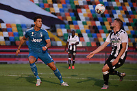 Aaron Ramsey of Udinese and Cristiano Ronaldo of Juventus <br /> during the Serie A football match between Udinese Calcio and Juventus FC at Friuli stadium in Udine <br />  (Italy), July 23th, 2020. Play resumes behind closed doors following the outbreak of the coronavirus disease. Photo Federico Tardito / Insidefoto