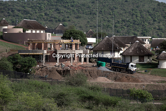 NKANDLA, SOUTH AFRICA - OCTOBER 10: Construction on a building at the home for South Africa president Jacob Zuma's in his birth village on October 10, 2012 in KwaNxamalala, Nkandla. South Africa.  The South African government is spending R240-million (about US$ 27 million) to construct the vast property for his large family. (Photo by Per-Anders Pettersson)