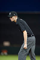 Minor League Baseball umpire Nathan Diederich handles the calls at first base during a game between the AZL Rangers and AZL Giants on September 4, 2017 at Scottsdale Stadium in Scottsdale, Arizona. AZL Giants defeated the AZL Rangers 6-5 to advance to the Arizona League Championship Series. (Zachary Lucy/Four Seam Images)