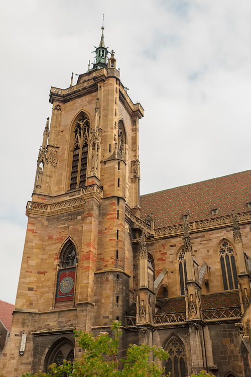 Striking architecture is found of the exterior of Colmar's Dominican Church which contrasts to the rather plain walls inside.