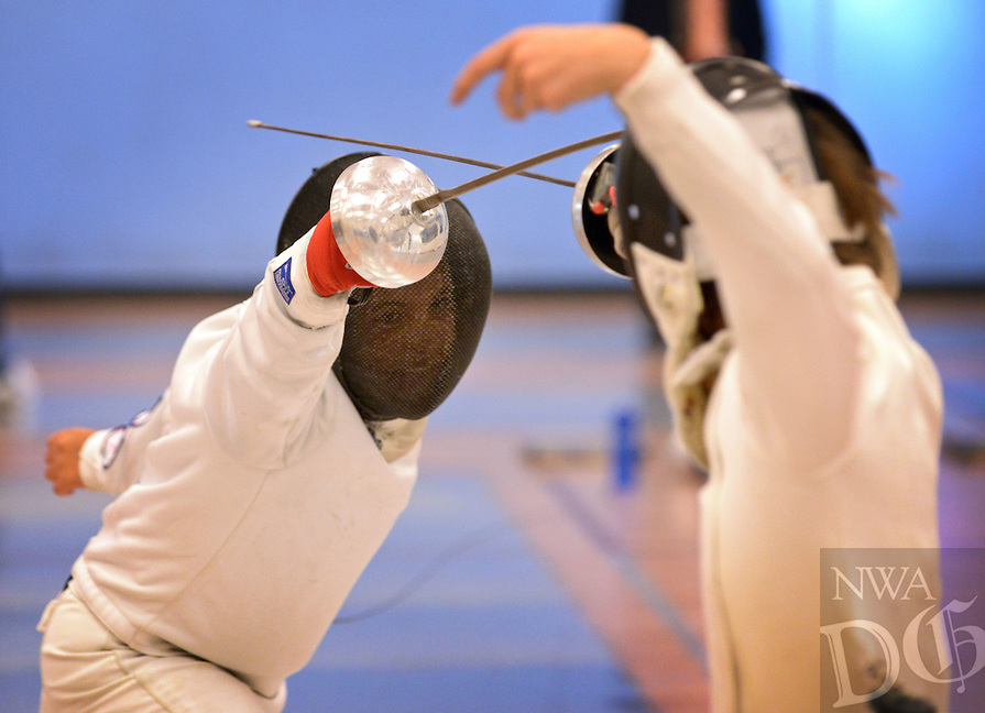 NWA Democrat-Gazette/BEN GOFF @NWABENGOFF<br /> Riley Parker (left) takes on Noe Jean, both 11 and from the Texas Fencing Academy in Austin, in the Y12 epee semifinals on Sunday Oct. 18, 2015 during the 3 Swords Regional Youth Circuit fencing tournament at Northwest Arkansas Fencing Center in Bentonville. Parker advanced to the final and won the Y12 epee event. The three-day tournament was part of a qualifying path to youth Summer Nationals next year in Salt Lake City, Utah, and proceeds benefitted the Northwest Arkansas Fencing Foundation, the non-profit wing of the Northwest Arkansas Fencing Center dedicated to helping under-served and at-risk youth age 6-18 through the sport of fencing.