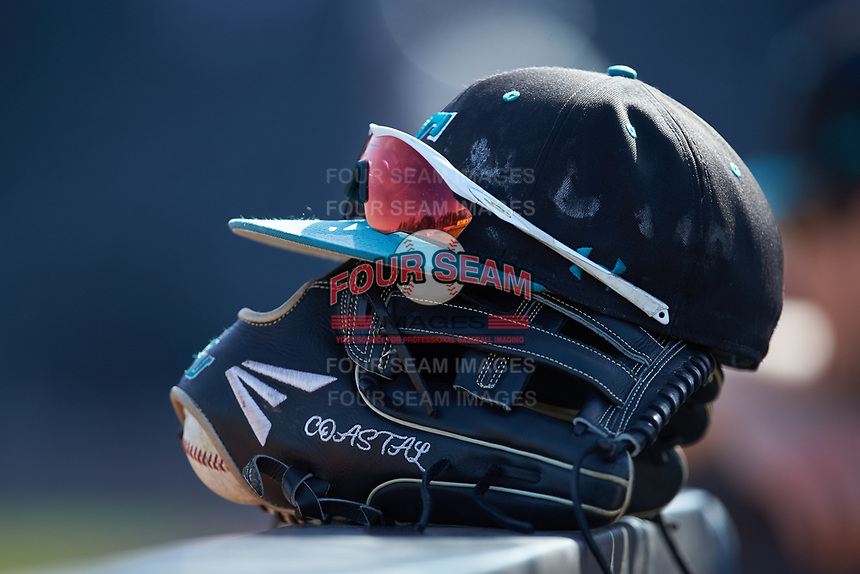A Coastal Carolina Chanticleers cap sits on top of an Easton brand baseball glove during the game against the Duke Blue Devils at Segra Stadium on November 2, 2019 in Fayetteville, North Carolina. (Brian Westerholt/Four Seam Images)
