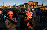 A pair of Arab workers from southern Iraq stand on a busy commercial street in central Suleymaniah, Iraqi Kurdistan on Mon. September 18, 2006 hoping someone will offer them work. Tens of thousands of Arab Iraqis have migrated north seeking jobs and security and fleeing the relentless violence of their home cities in recent months. Some have found refuge and stability but many, like these two, live precariously working as day laborers at construction and other menial jobs.