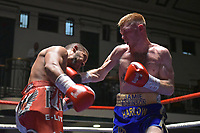 Jamie Robinson (blue shorts) defeats Radoslav Mitev during a Boxing Show at York Hall on 30th June 2018
