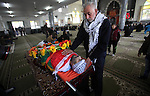 Mourners gather around the body of Palestinian Jihad Khalil, who according to the Israeli police was shot and killed by an Israeli security guard after Khalil tried to stab him last November, during his funeral after Israel released his body, in the West Bank village of Beit Wazan near Nablus December 24, 2016. Photo by Nedal Eshtayah