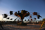 Palestinians take a ride at an amusement park on the third day of Eid al-Adha or the feast of sacrifice in Gaza city, on August 2, 2020. Muslims are celebrating Eid al-Adha (the feast of sacrifice), the second of two Islamic holidays celebrated worldwide marking the end of the annual pilgrimage or Hajj to the Saudi holy city of Mecca. Photo by Ashraf Amra